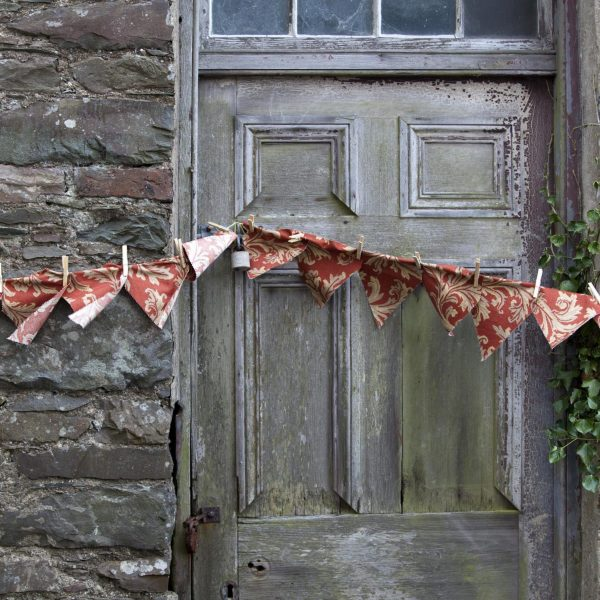 Rustic bunting on an old wooden door and stone wall, Wigtown