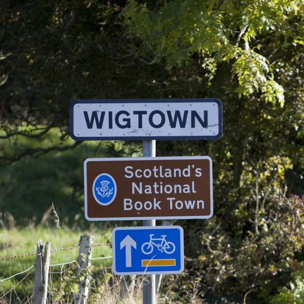 Wigtown: Scotland's National Book Town. Road signage on a grassy verge
